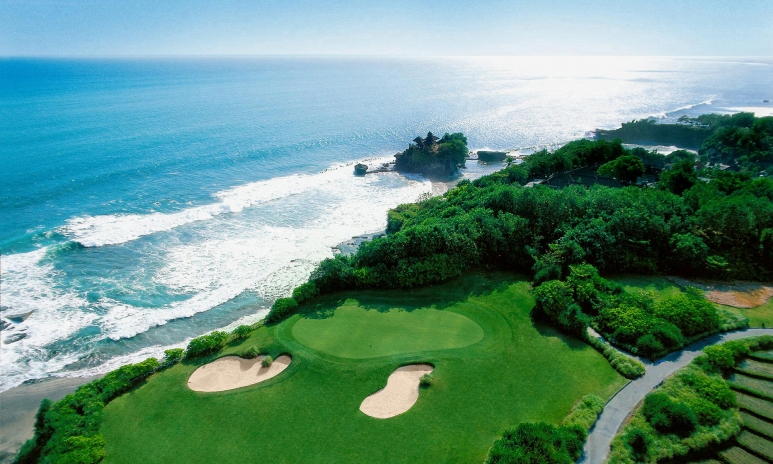 Arial view overlooking Tanah Lot temple and golf course at Pan Pacific Nirwana Bali Resort (7th green).jpg