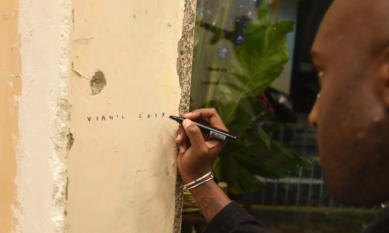OFF-WHITE Designer - Mr. Virgil Abloh is signing on the wall of Central Shop.JPG