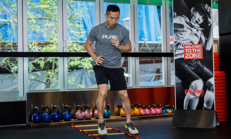Pure Fitness Group Instructor Jay Wang performing a high intensity circuit.jpg